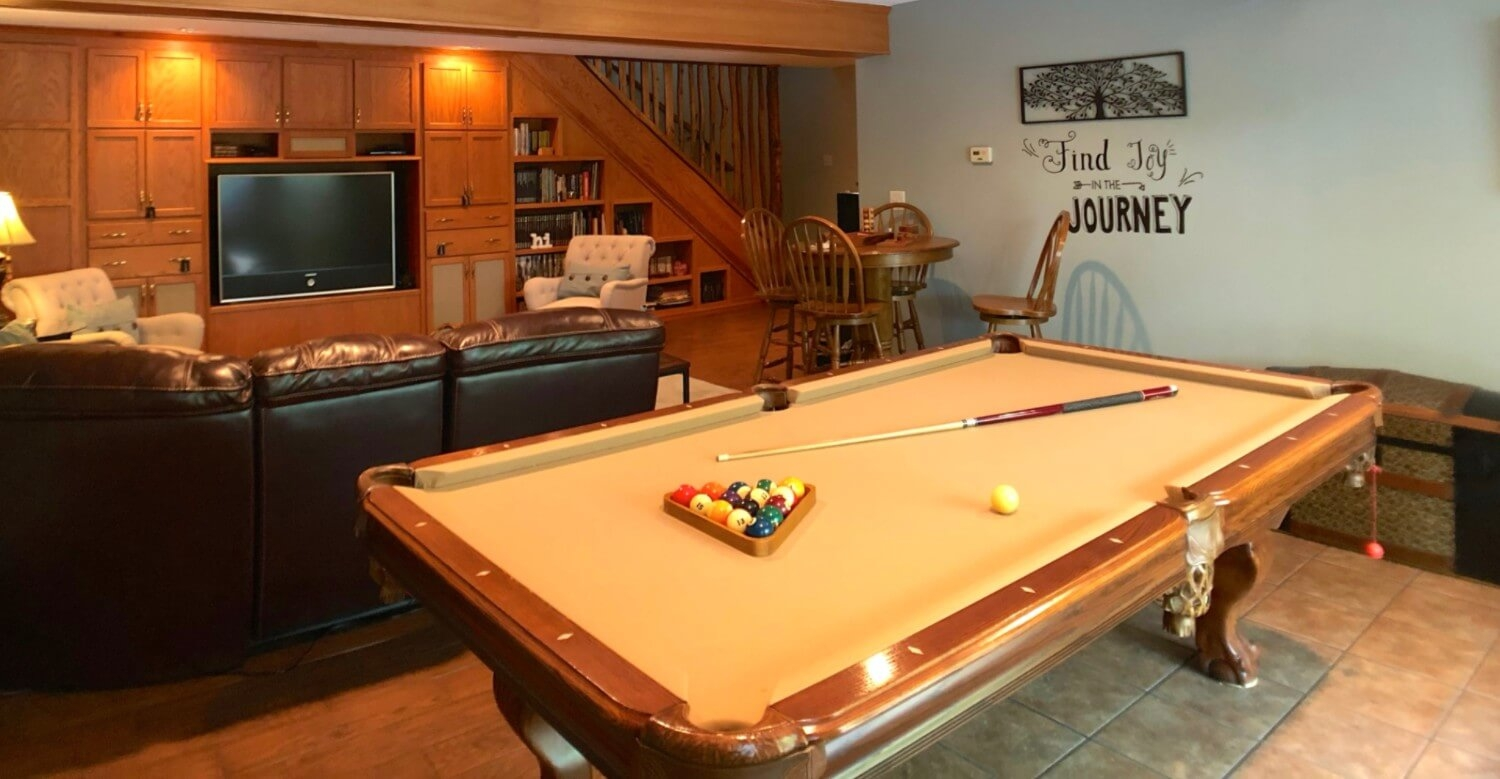 Common area with leather sectional, TV and pool table