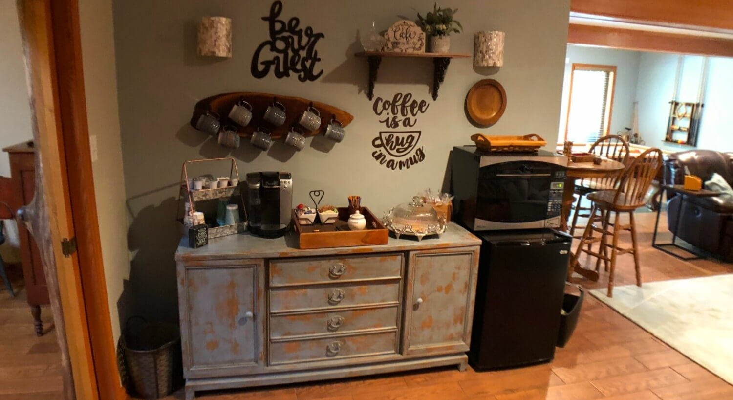 blue sideboard with coffee station and microwave
