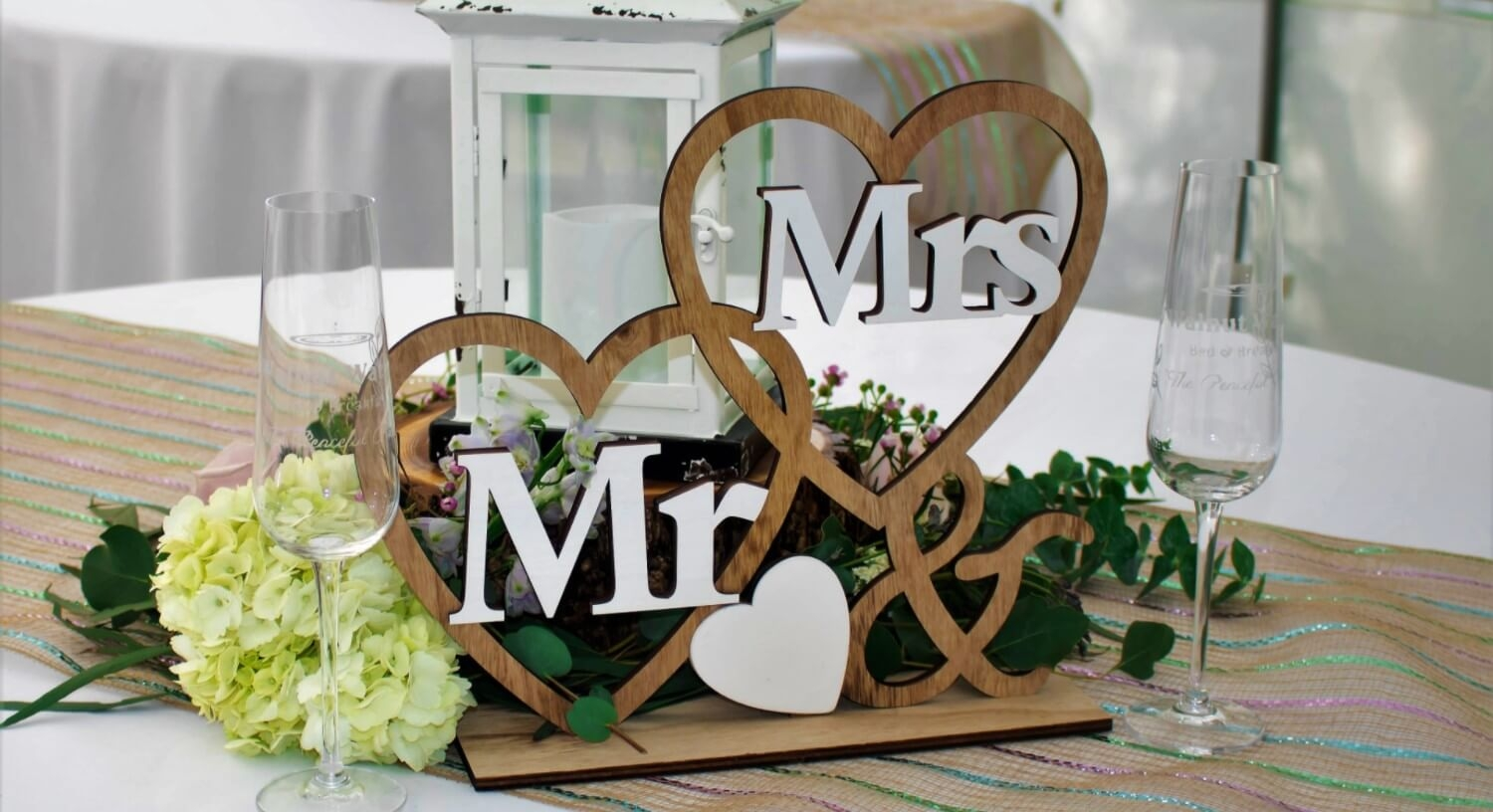 Mr & Mrs wooden centerpiece with fresh white flowers and greenery