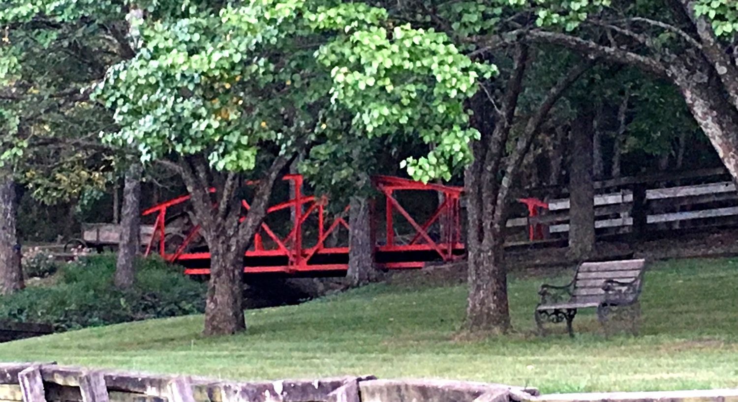 View of red bridge through the trees
