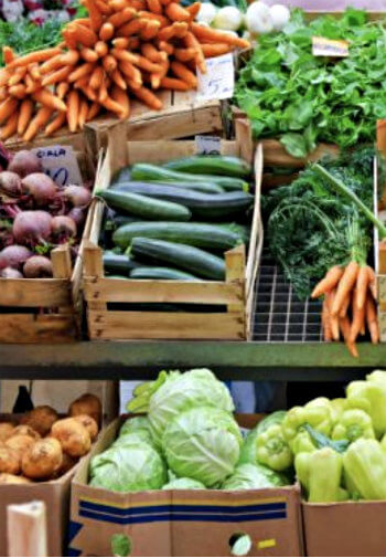 Wooden crates full of fresh vegetables at a market